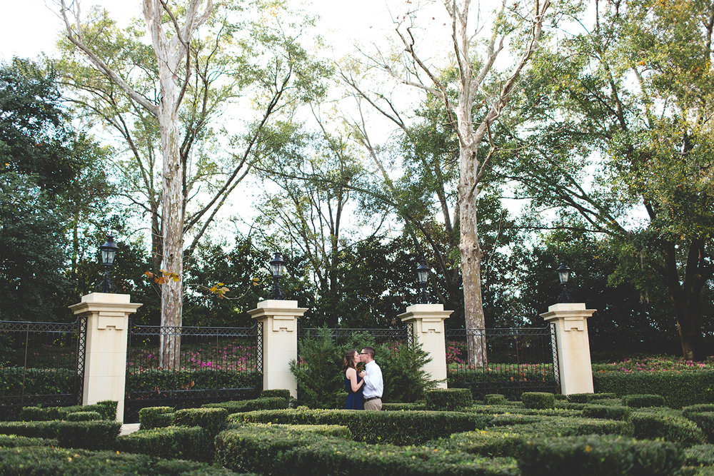 jaime DiOrio - Epcot Engagement photo - Epcot Engagement Session - couple kissing at epcot in the garden - Disney Engagement photo - orlando wedding photographer.jpg