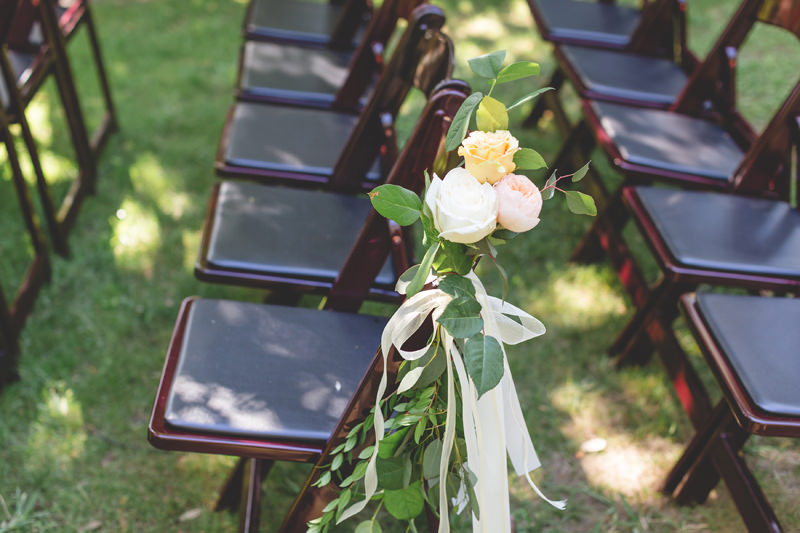 outdoor ceremony chairs in dark wood