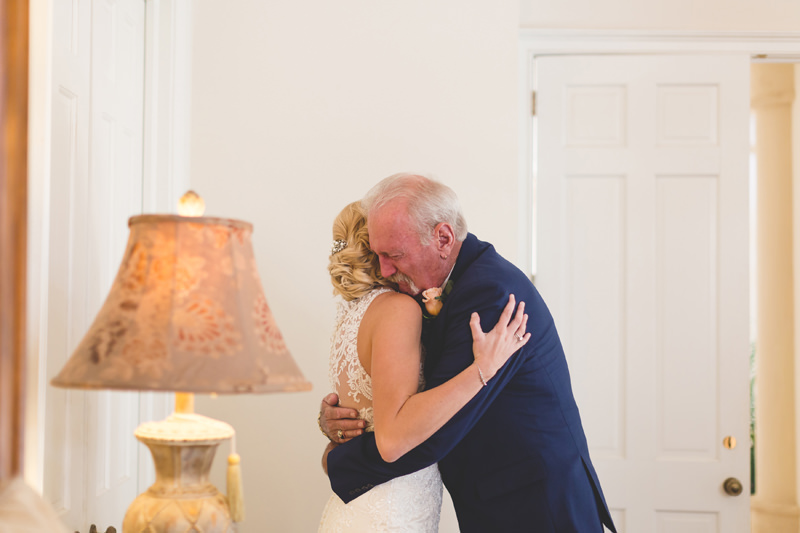 A hug between the Bride and the Father of the Bride at the First Look
