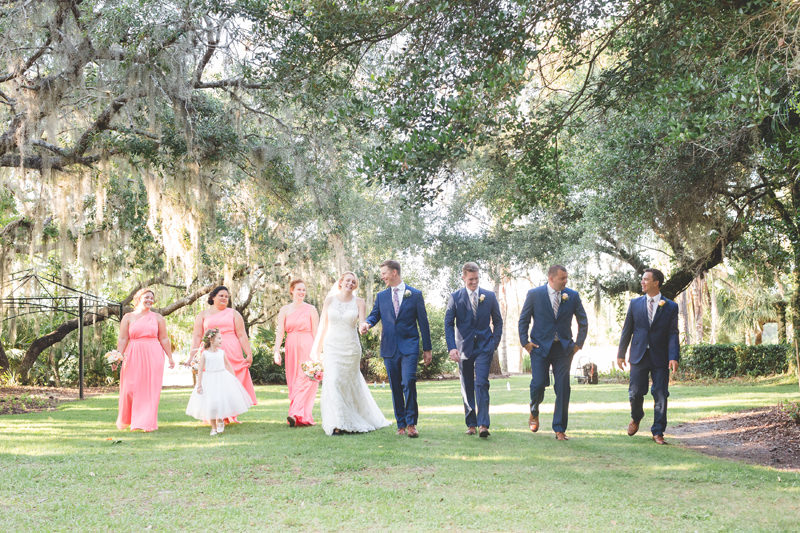 Fun photo of wedding party walking with Bride and Groom