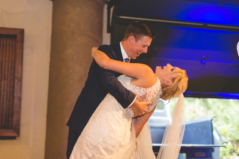 Bride and Groom having fun and laughing at Reception