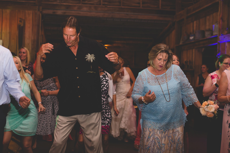 Wedding Guests having a fun time dancing at reception