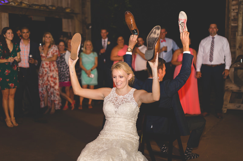 Bride smiling while playing shoe game at wedding reception