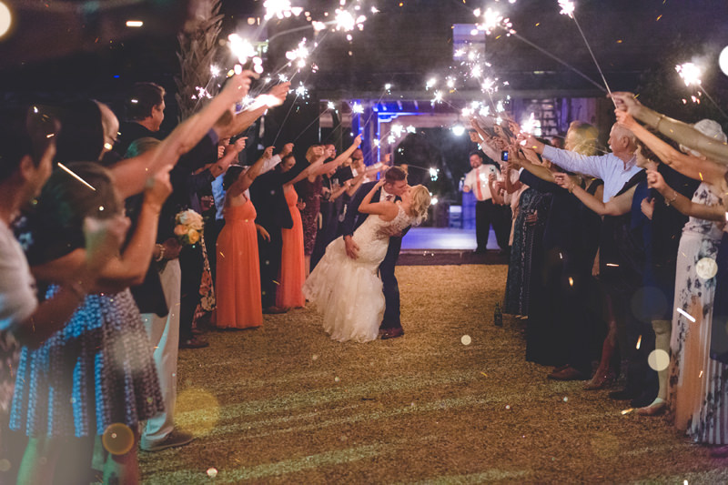Bride and Groom kissing during sparkler exit at outdoor spring wedding at Floridian Manor Estate