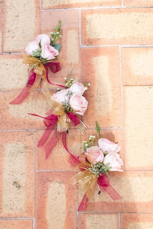 Pink mini spray rose boutonniere for a Disney Themed Wedding