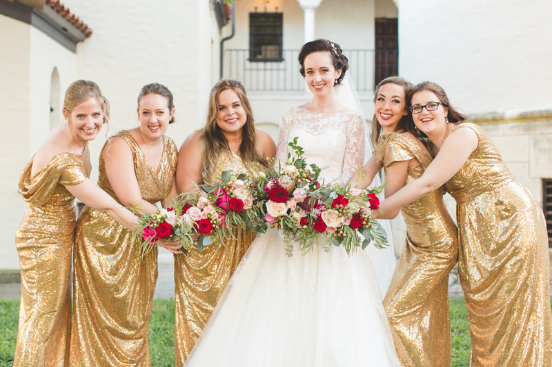 Bride with Bridesmaid in Gold Sequins dresses with red and pink bouquets