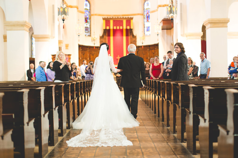 Bride walking down aisle with Father of the Bride at Knowles Memorial Chapel wedding