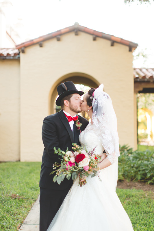 Bride and Groom kissing with Mickey ears on their wedding day