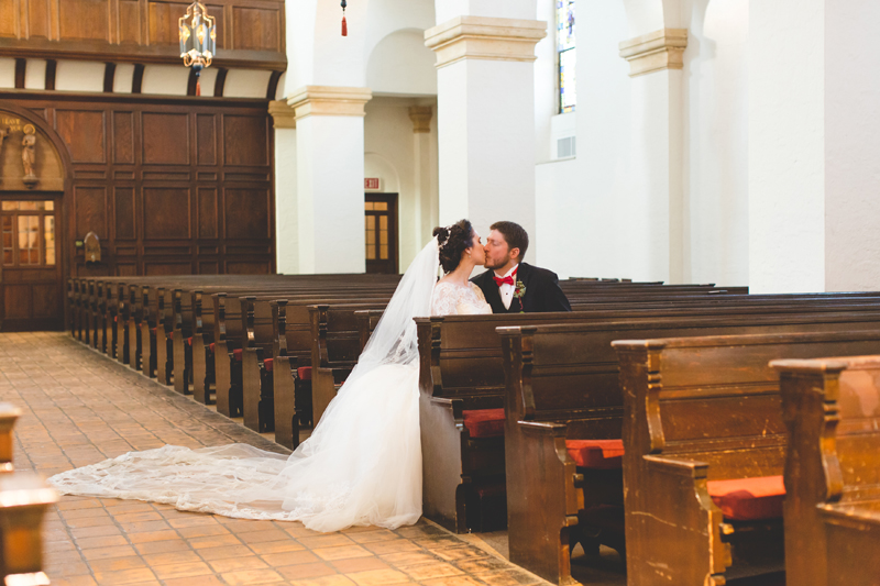 Bride and Groom kissing at their Knowles Memorial Chapel at Rollins College wedding
