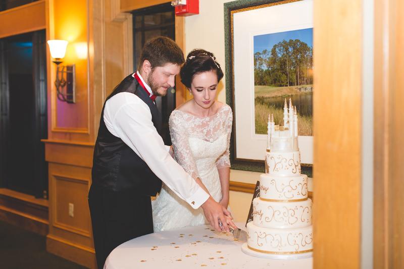 Bride and Groom cutting Disney wedding cake