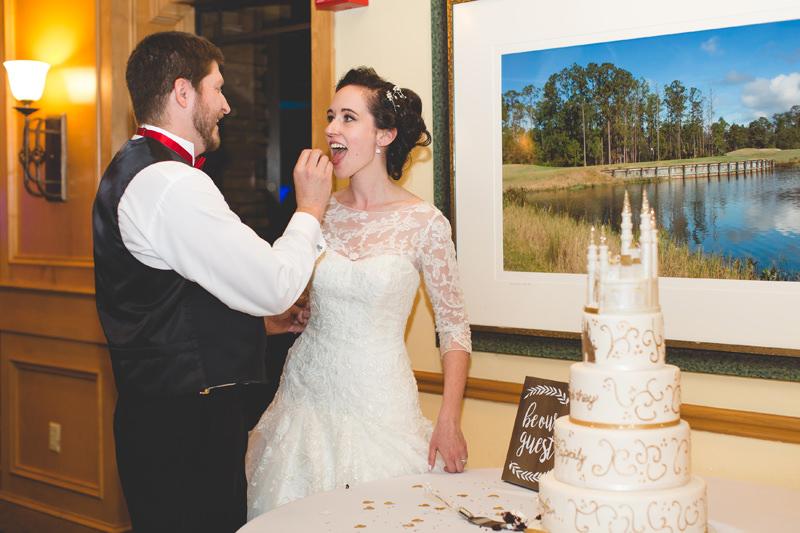 Groom feeding Bride Disney Wedding Cake