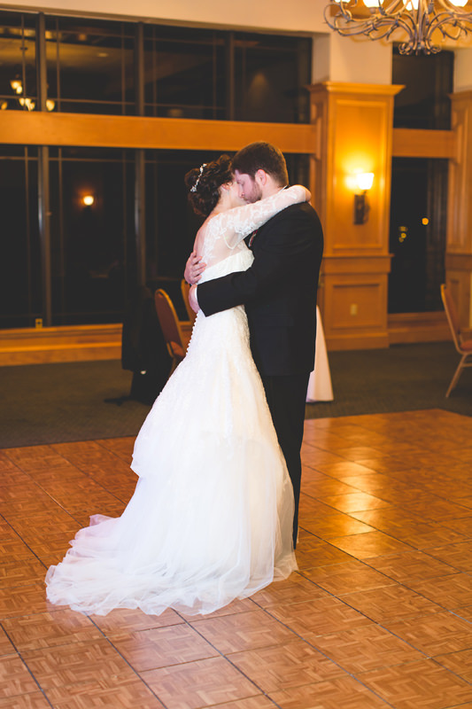 Bride and Groom slow dancing at reception