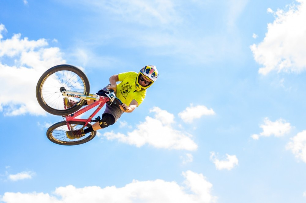 A slopestyle biker getting big air at Riverrock 2014