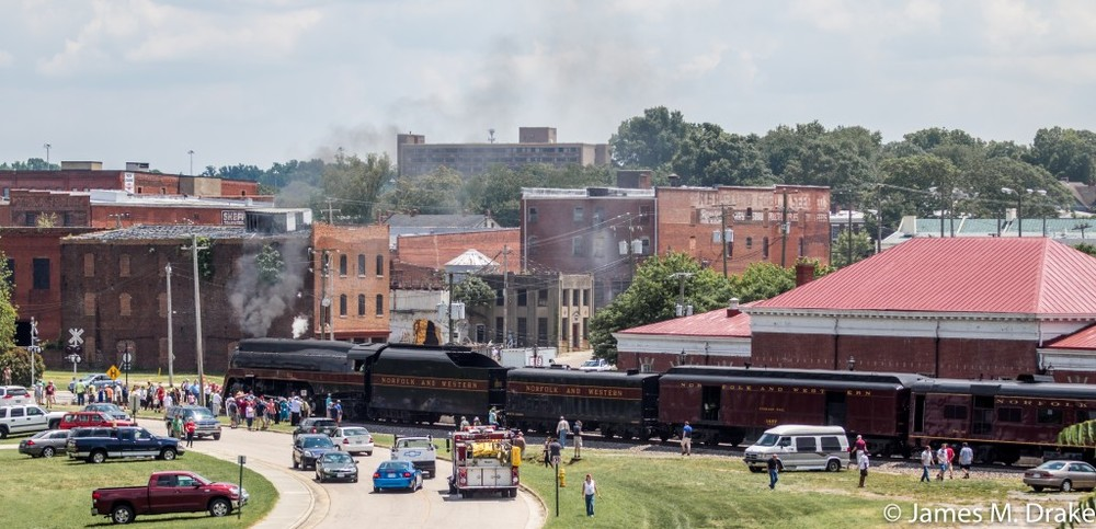 A crowd gathers as Steam Engine 611 visits Union Station in Petersburg, Virginia.