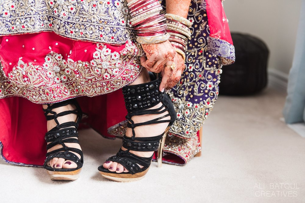 Uzma took her traditional Pakistani wedding dress to the next level with a pair of funky black and gold heels.