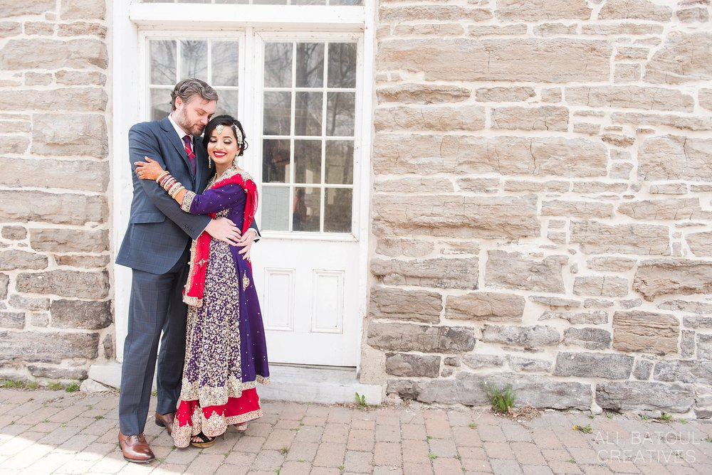 The bride and groom decided to have their portraits taken at a beautiful 1860s industrial heritage site,Watson's Mill in Manotick.