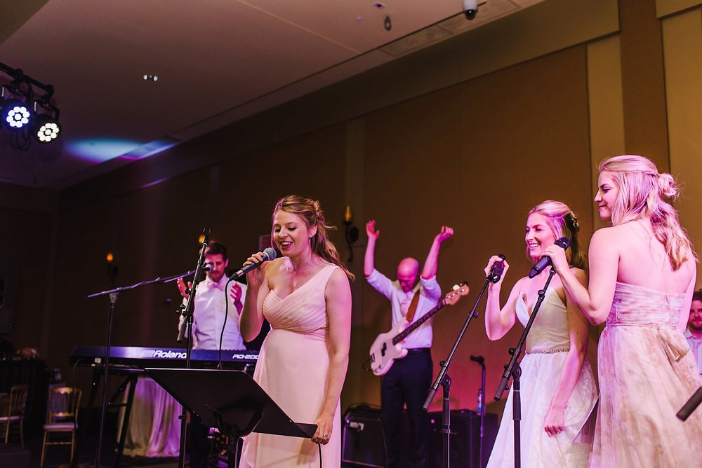 The bride got on stage with her sisters, who are equally as talented!