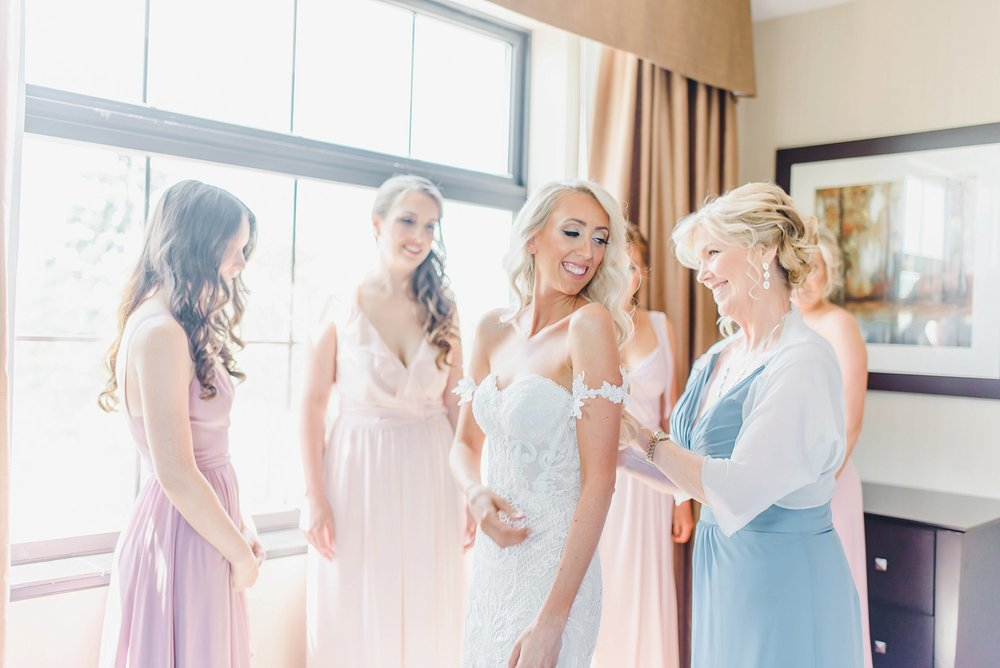 Kaylea's sweet mom helped her get into her gorgeous dress from Revelle Bridal.