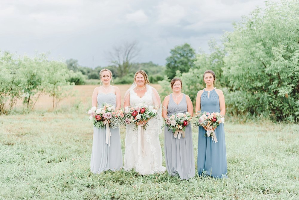 The ladies hopped in for a few moments to get photos of all of them together in their soft blue and grey bridesmaids dresses.