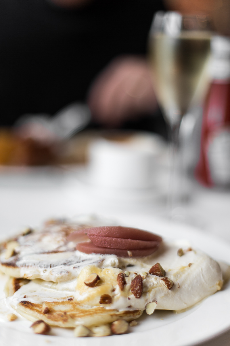 Pancakes with quince, apple caramel, smoked almonds, and cream at Bistrotheque, London
