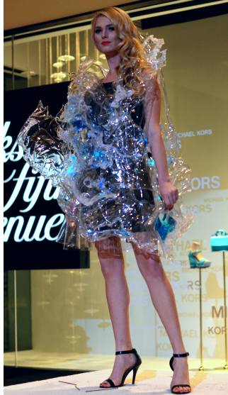 Your Observer newspaper Artists create fashions out of unconventional materials for the iConcept Runway Show by: Heather Merriman Saba Black Tie Editor Monday, Feb. 22, 2016 |     Kathleen Wisneski models Alexandra Lin's 'A Splash of Sarasota' — made from recyclable plastic, packaging, water and Sarasota sand.