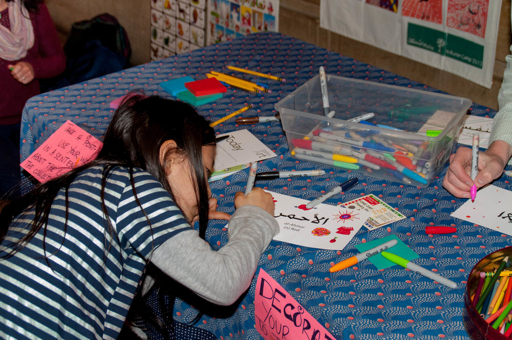 Nasij:  Weaving Our Cultures into a Collective Poem.  Poetry Station by Al-Bustan Seeds of Culture. Photo by Tieshka Smith.