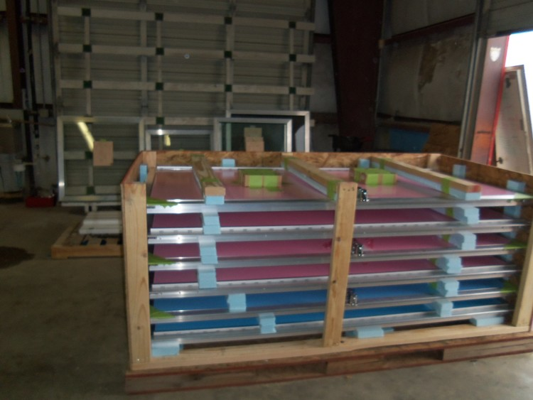 Tidalwave™ mandoors being placed in a crate ready for shipping anywhere in the world.