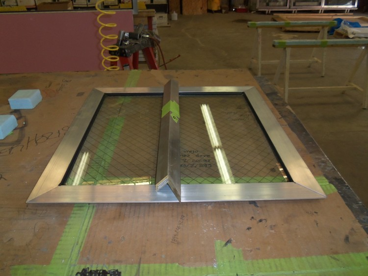 Custom made Tidalwave™ window with safety glass and aluminum trim.