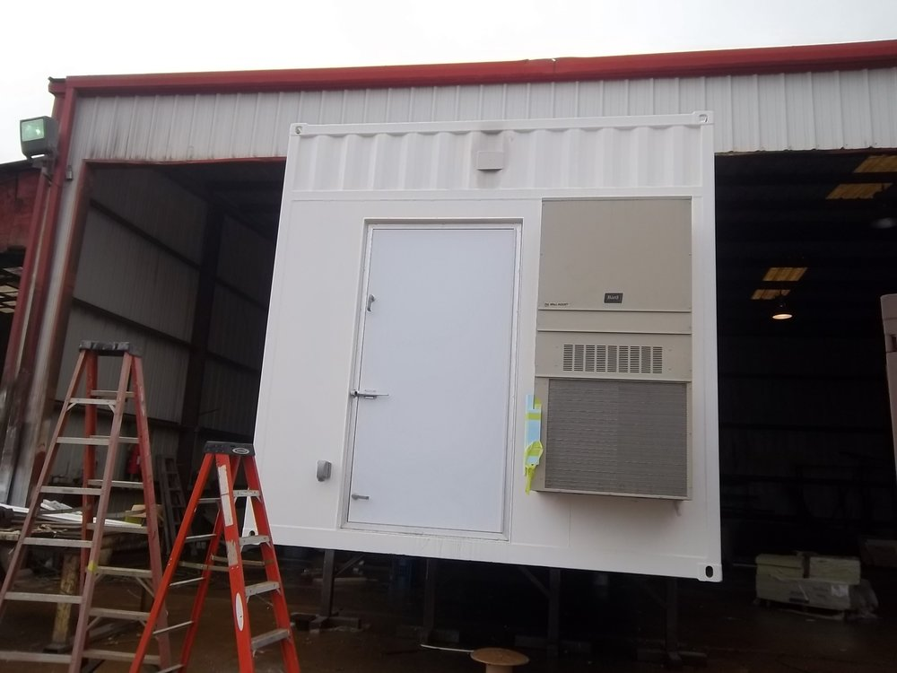Custom Tidalwave mandoor (wider and taller); wall-mount HVAC.