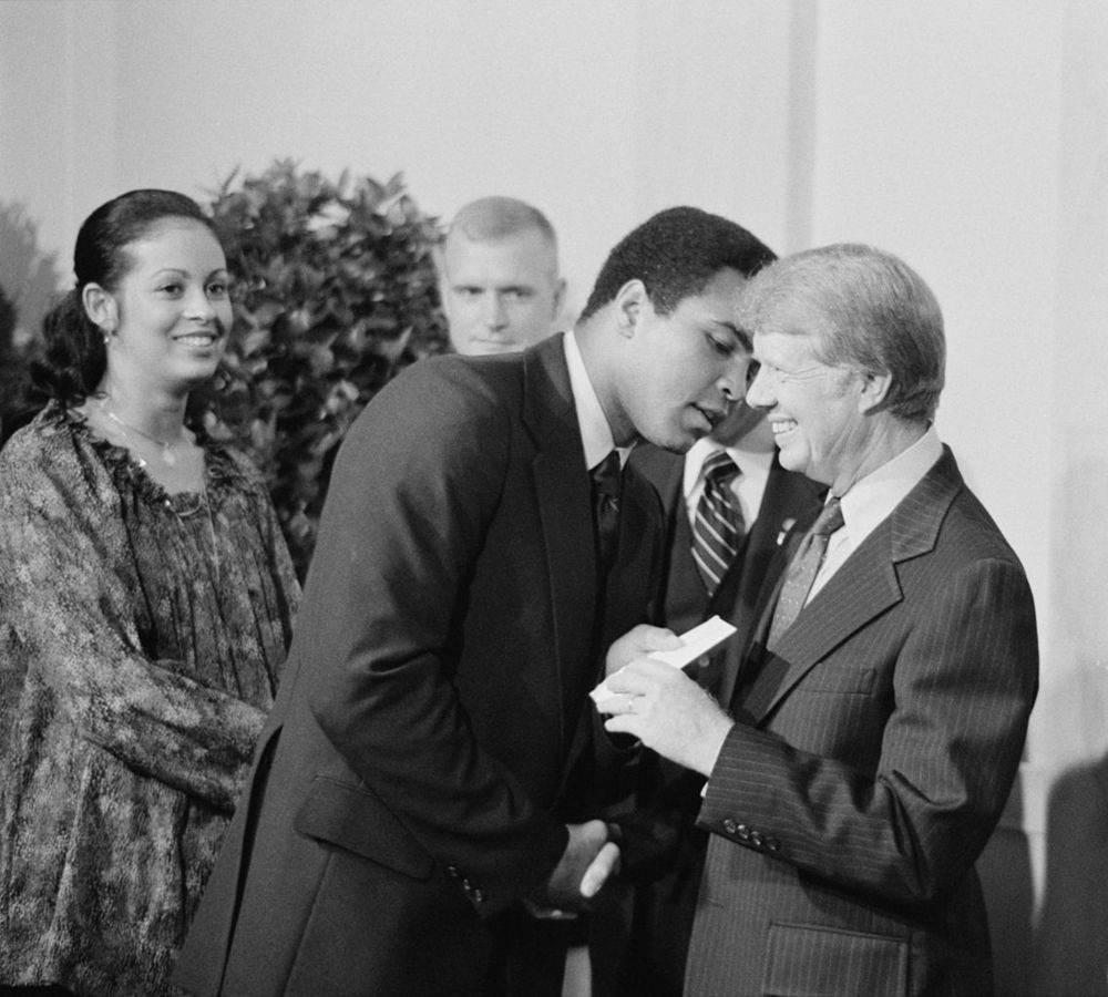 President Jimmy Carter greets Muhammad Ali at a White House dinner - September 7, 1977