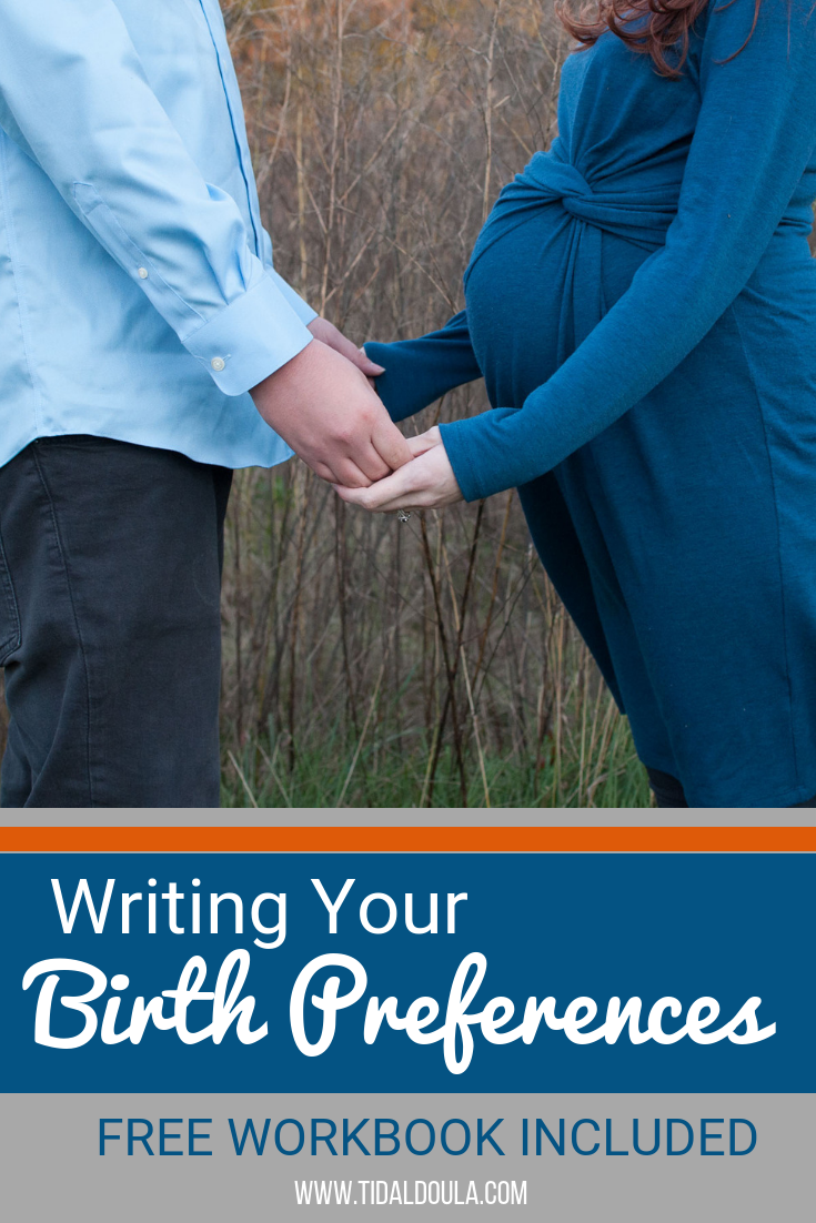 Two fair skinned people holding hands over a next to a pregnant belly. They're both wearing blue and are standing in a field of grass. The caption reads: Writing your birth preferences, free workbook included.