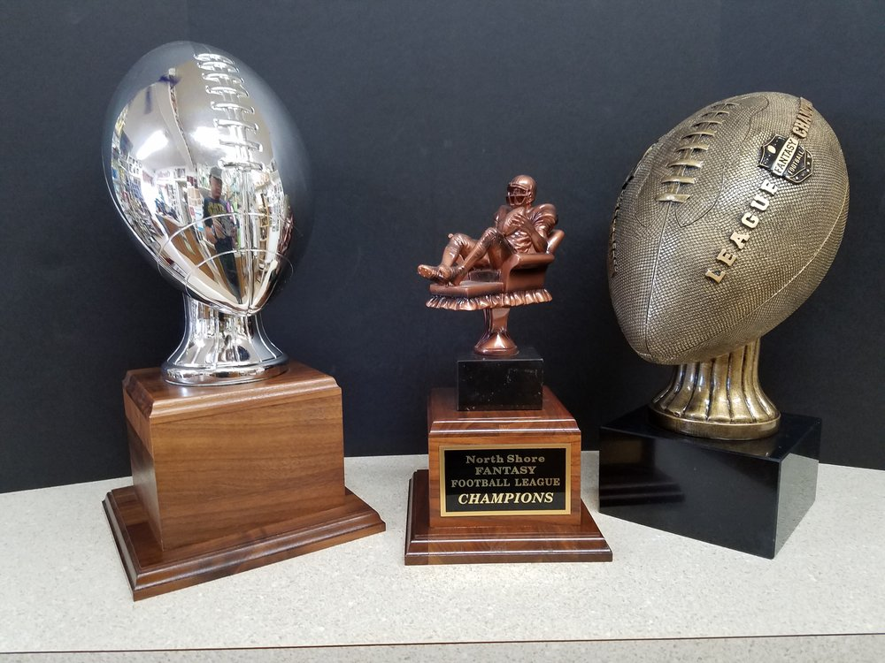 "SILVER FOOTBALL (15"") - 182.00, FANTASY FOOTBALL TROPHY (12"") - 126.00, FANTASY LEAGUE CHAMPION BALL (13"") - 149.00"