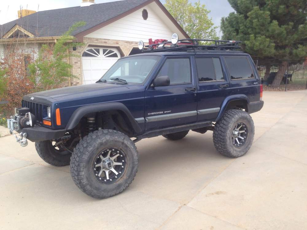 "2000 Jeep Cherokee XJ, 8"" Long Arm Lift, Rubicon 4 to1 Transfer Case, Rubicon Dana 44's  4.88's,35-17 BFG K2's  Rockhard Cage, Custom Bumpers & Side Bars"