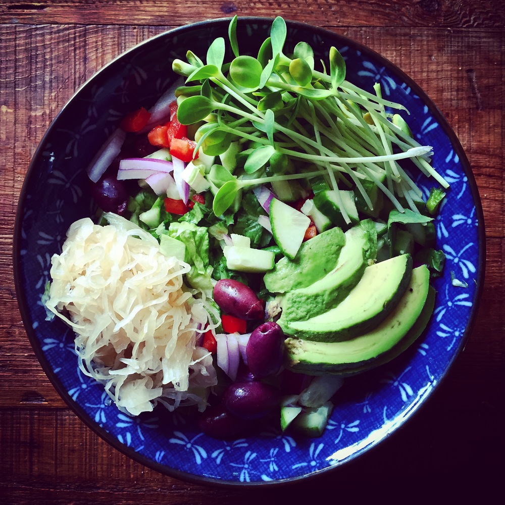 Kraut, olives, sprouts, avocado, peppers, onion, no dressing {just mash it all up!}