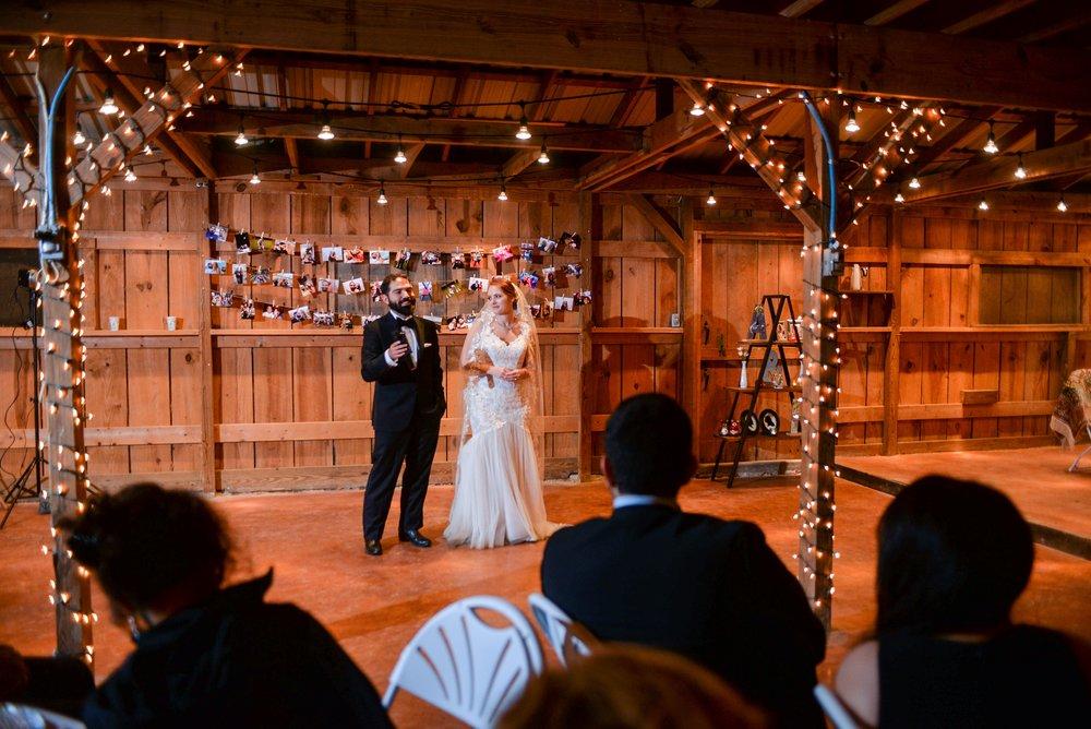 bride and groom in barn.jpg
