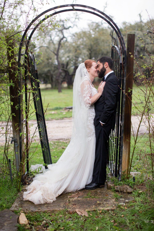 couple at  wrought iron trellis.jpg