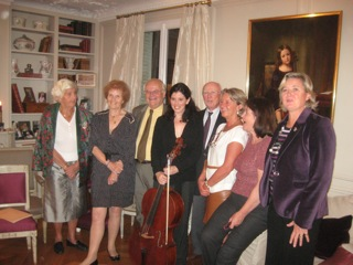 Louise with 7 direct descendants of Franchomme, Paris 2011: Elisabeth, Claire, Thierry, me, Denys, Marie-Christine, Florence, and Beatrice. A lovely 19th century painting of Auguste's son René in the background. René was a prodigy cellist and budding composer who died at age 19.