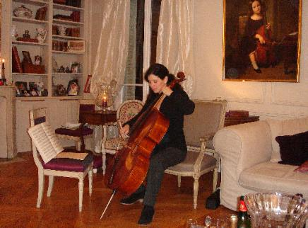 Louise playing Auguste Franchomme's Forster cello at a party in Paris, 2011. Among the guests were the seven Franchomme descendants pictured above!