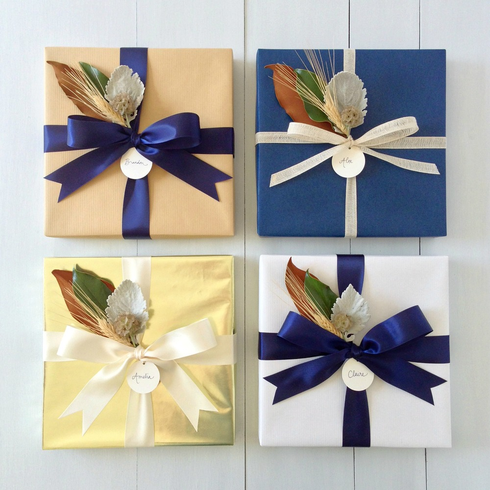 Gift wrap options: natural kraft, navy matte, metallic gold, white kraft. All gift wrapped boxes include a handcrafted artisanal topper and personalized gift tag.