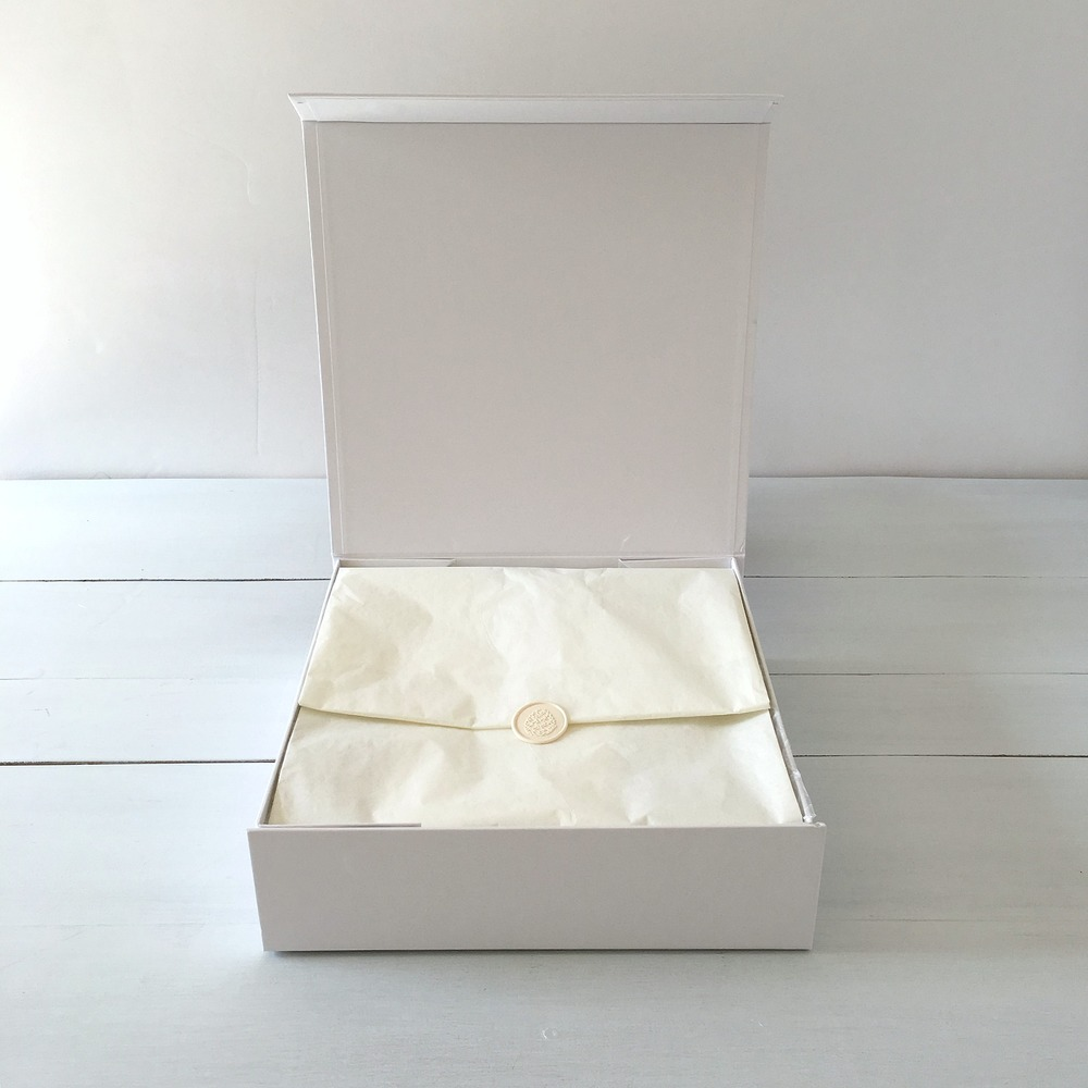 Fine packaging details include a keepsake box, wax-sealed interior, satin or linen ribbon, and a seasonal botanical gift topper handcrafted exclusively for  MEMENTO   &  MUSE.