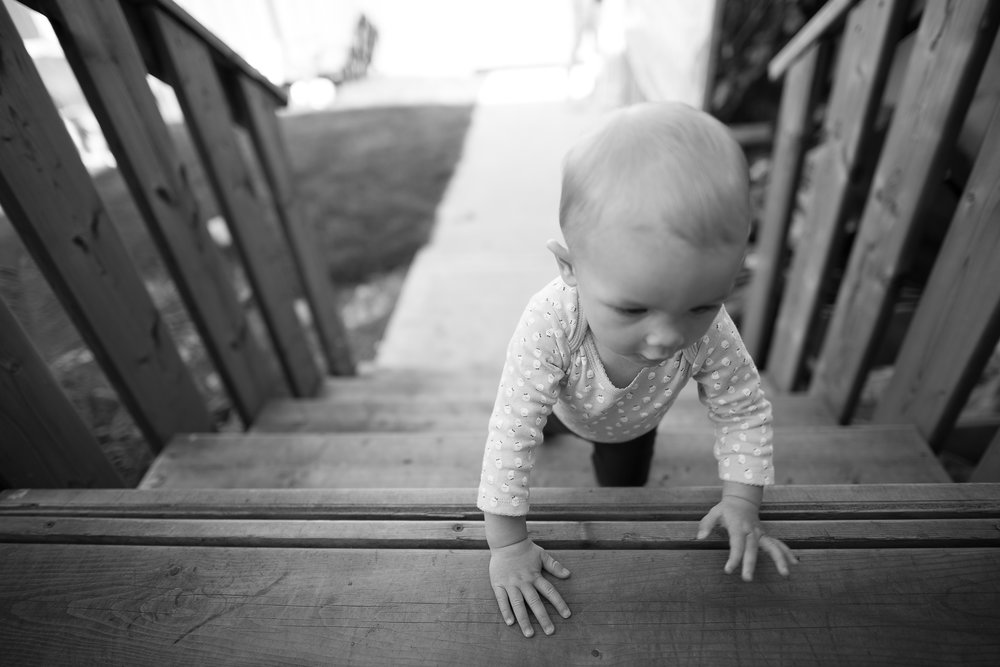 Focusing on her little hands moving quickly up the stairs                                    1/400 F1.4 ISO 100