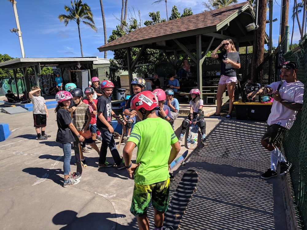"Sam of One Love, & Lo from Paia Youth & Cultural Center, pictured here bringing the fun & keeping track of points as students played ""Simons Says, Skate!"""
