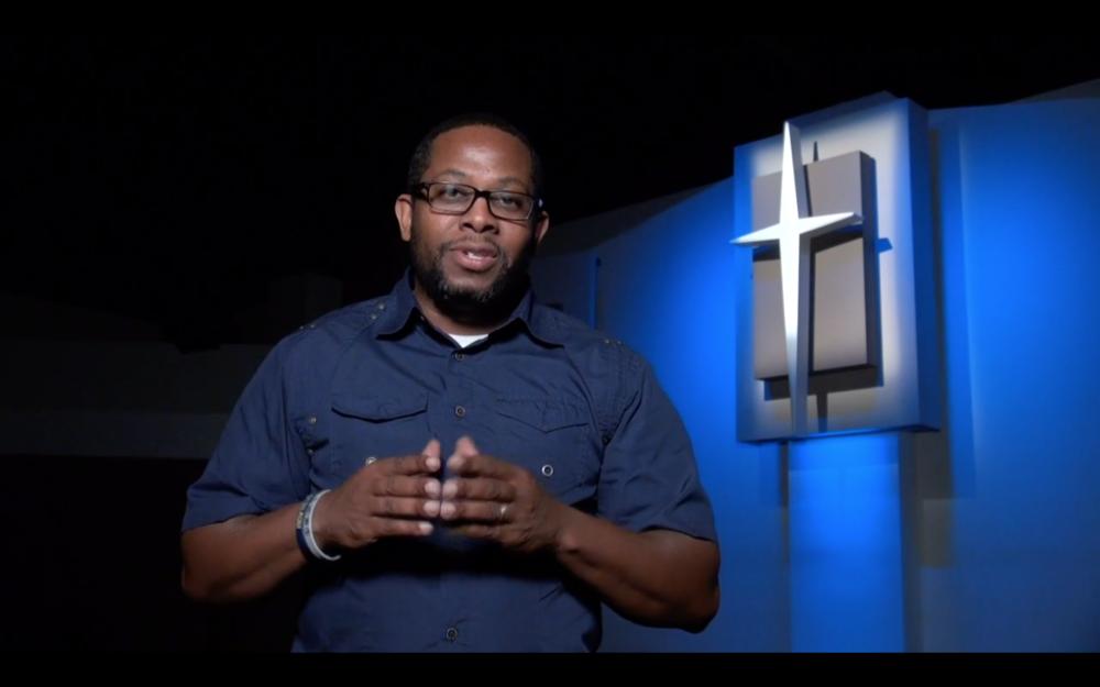 Rodney repping a 1L Wrist Band in the new Pleasant City Church Invite Video