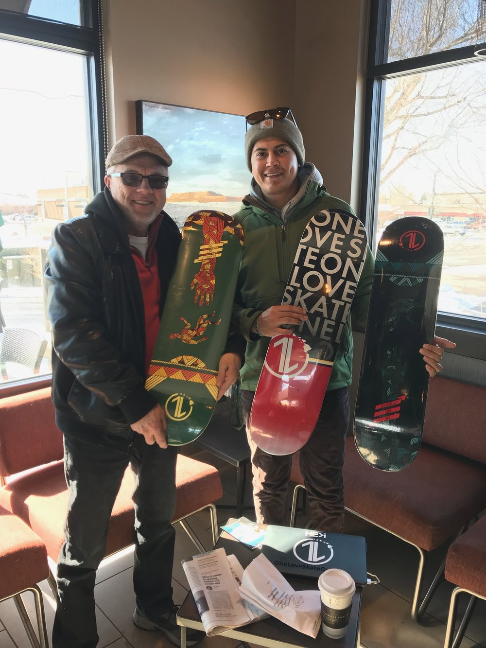 Auburn with his pastor at Harvest Church in Wyoming and the latest One Love Skate decks. Joshua & Auburn are planning to share about One Love Skate at Harvest Church in a couple weeks.