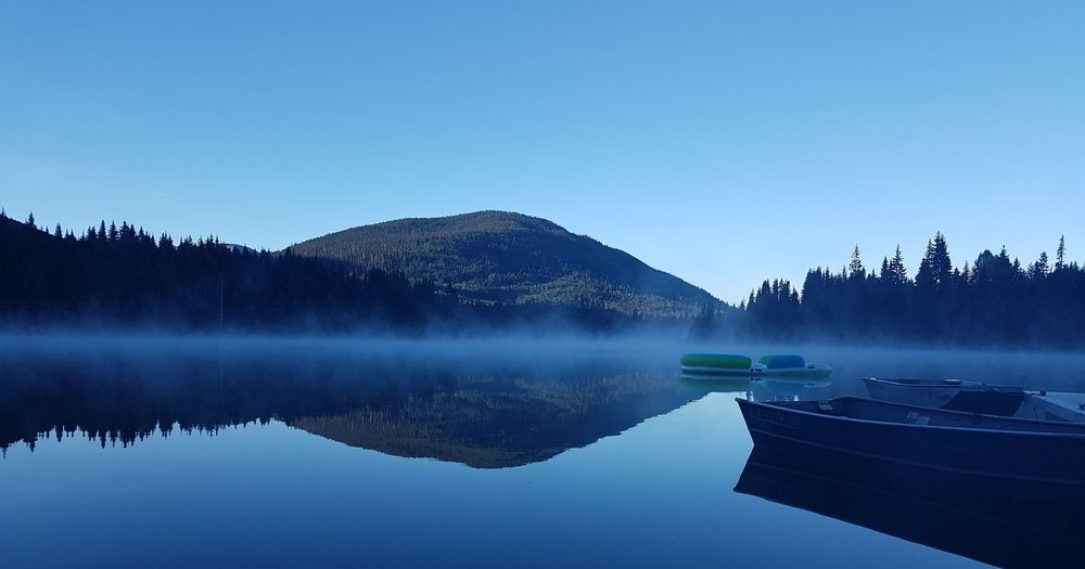 Mist rising from the lake at Coquihalla Lake Lodge just before sunrise