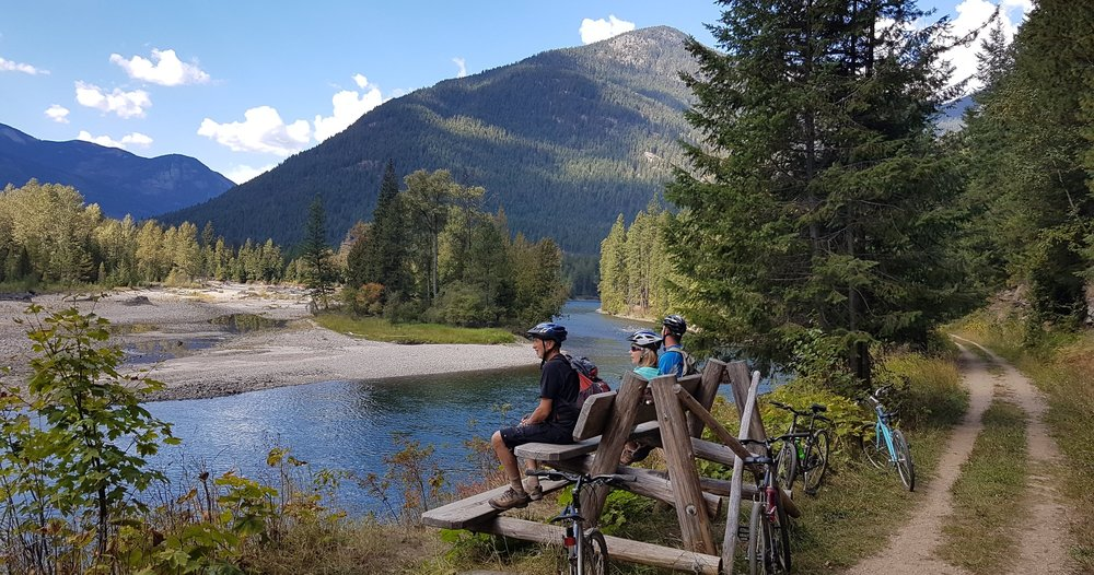 Taking a rest and enjoying the view along the Slocan Valley Trail