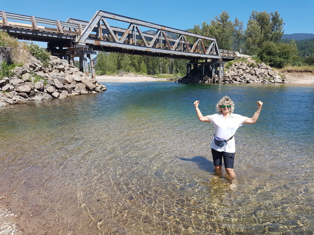 Cooling off in the Kettle river during our Okanagan Bike tour