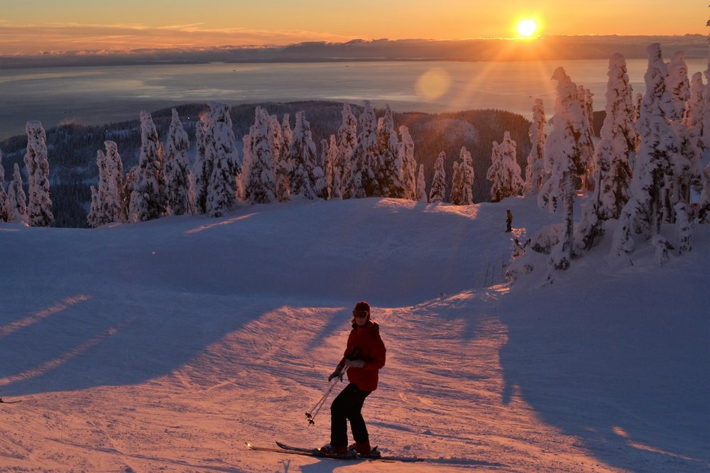 Skiing at one of the local mountains in Vancouver during sunset
