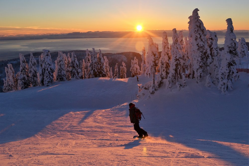 Snowboarder enjoying a late afternoon run in Vancouver