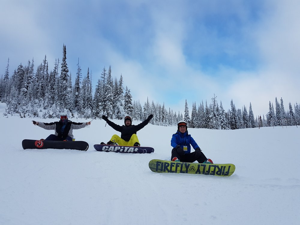 Three snowboarders enjoying their day tour in Vancouver